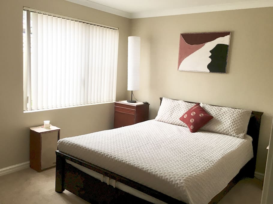 Queen bed, built in robes with plenty of hanging and shelf space