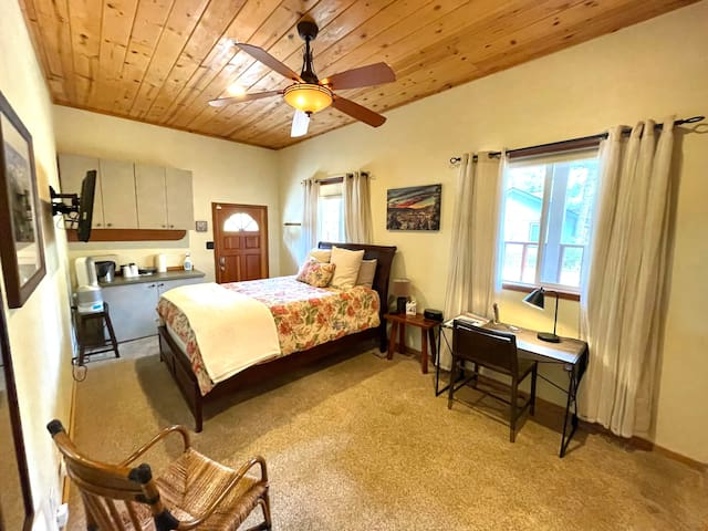 Guest room with very comfortable queen size bed, nice linens, and work space. Bathroom is located down the hall and private for guest use.