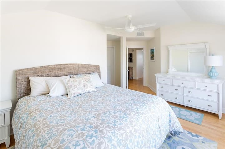 Master bedroom with king bed and en suite bathroom