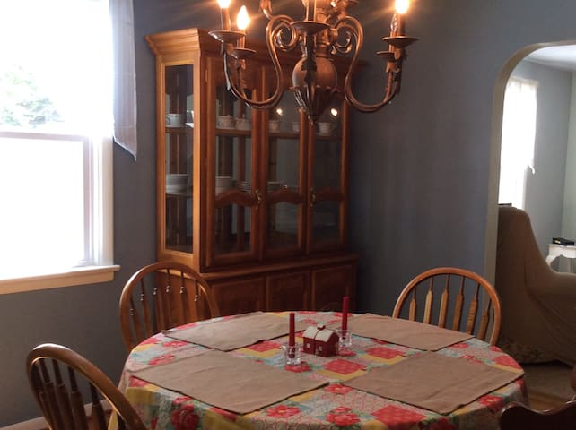Warm dining area. Oak table and chairs and hutch.