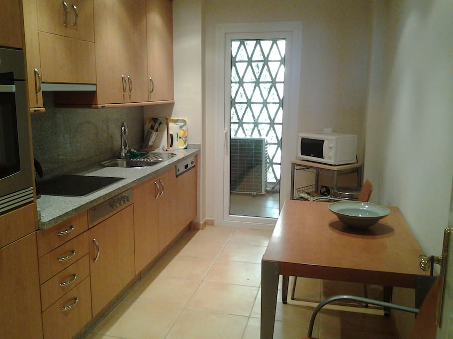 Fully equipped kitchen and utility room.
