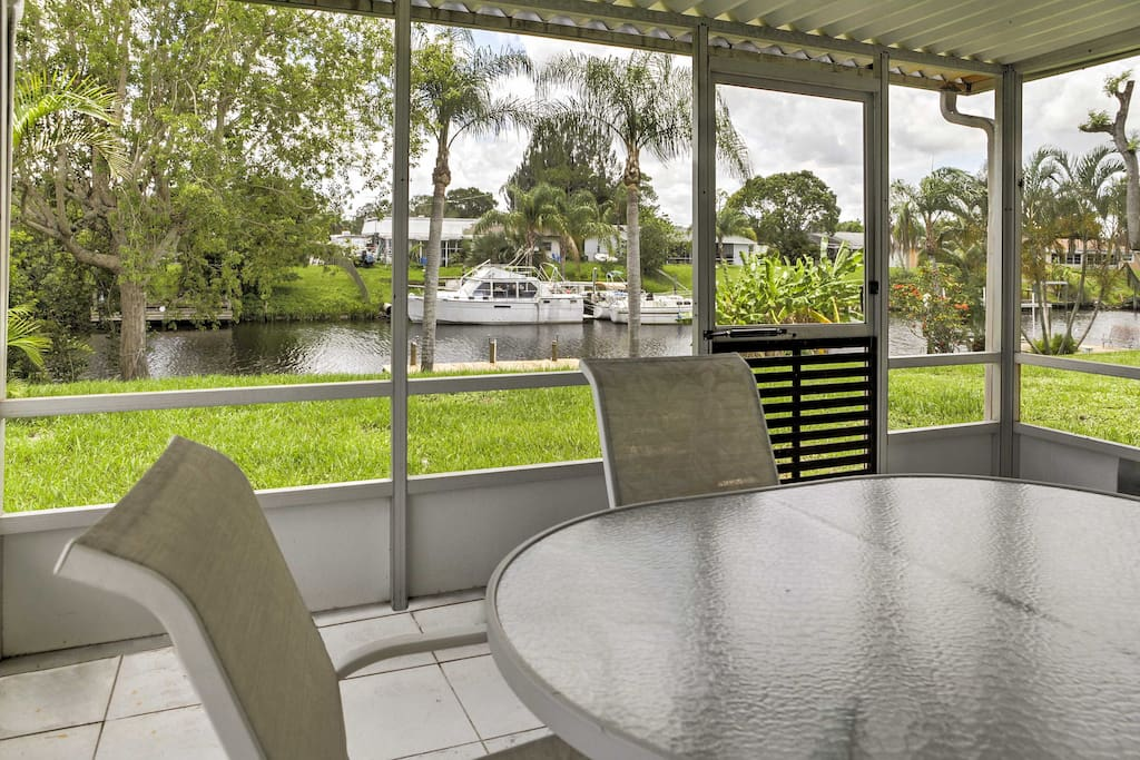 You'll love watching boats sail by on the canal while you relax in the screened-in sun room.