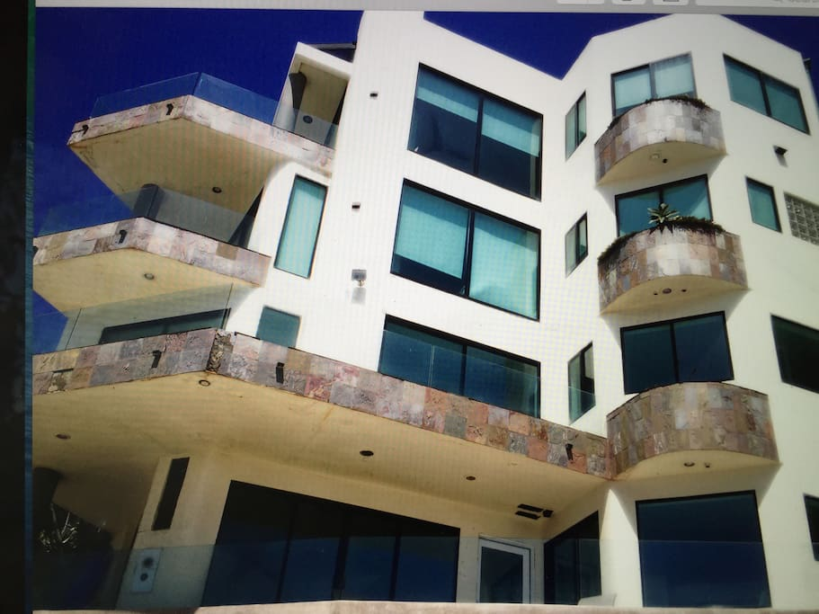 This is the view from the beach looking up at the house.  The top two floors represent the space for rent.