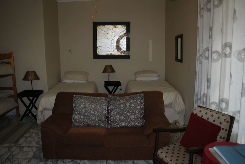 Family room 2 single beds convert into king bed, bunk beds for children, en-suite shower and kitchenette open plan room