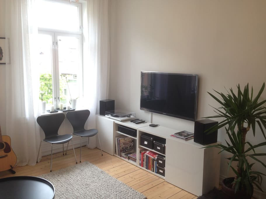 Living room with TV and stereo. Large windows!