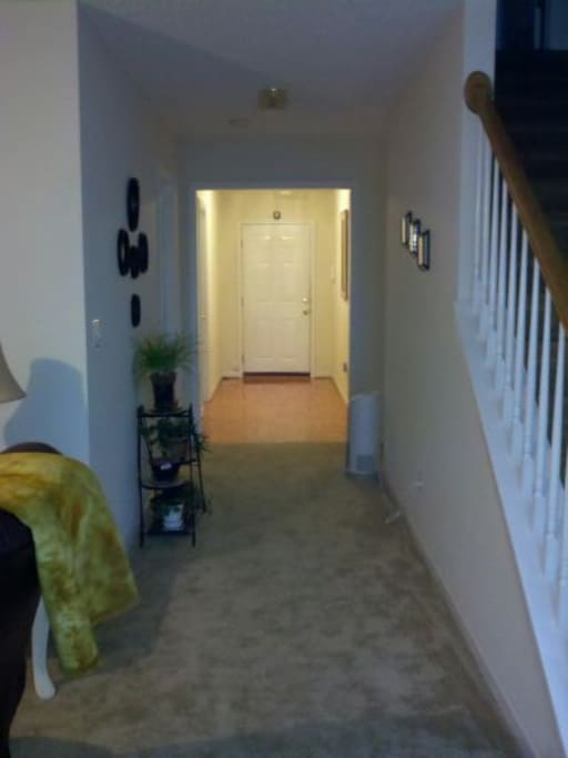Facing the front door. The guest room and bath are to the left of the front door.