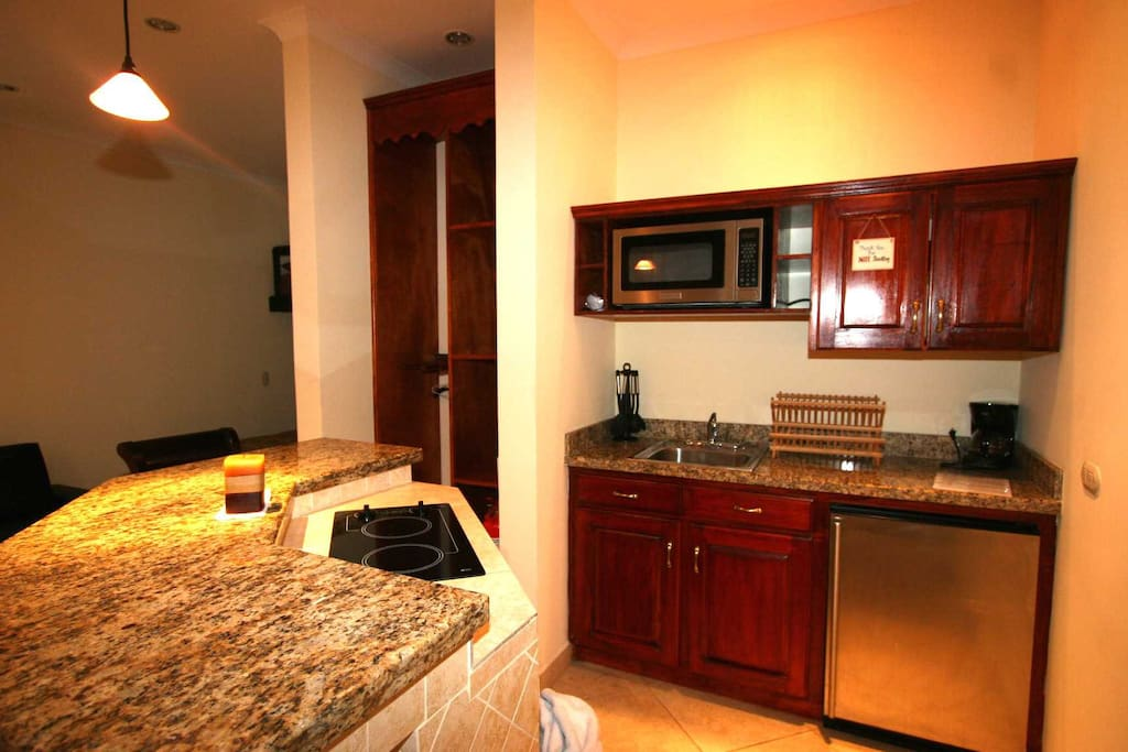 The Kitchen has a 2 burner electrical cook top, microwave, mini-fridge and coffee maker.