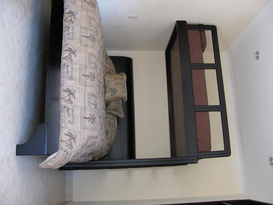 The beds are shown here, a queen and a full sized mattress for the bunk bed.