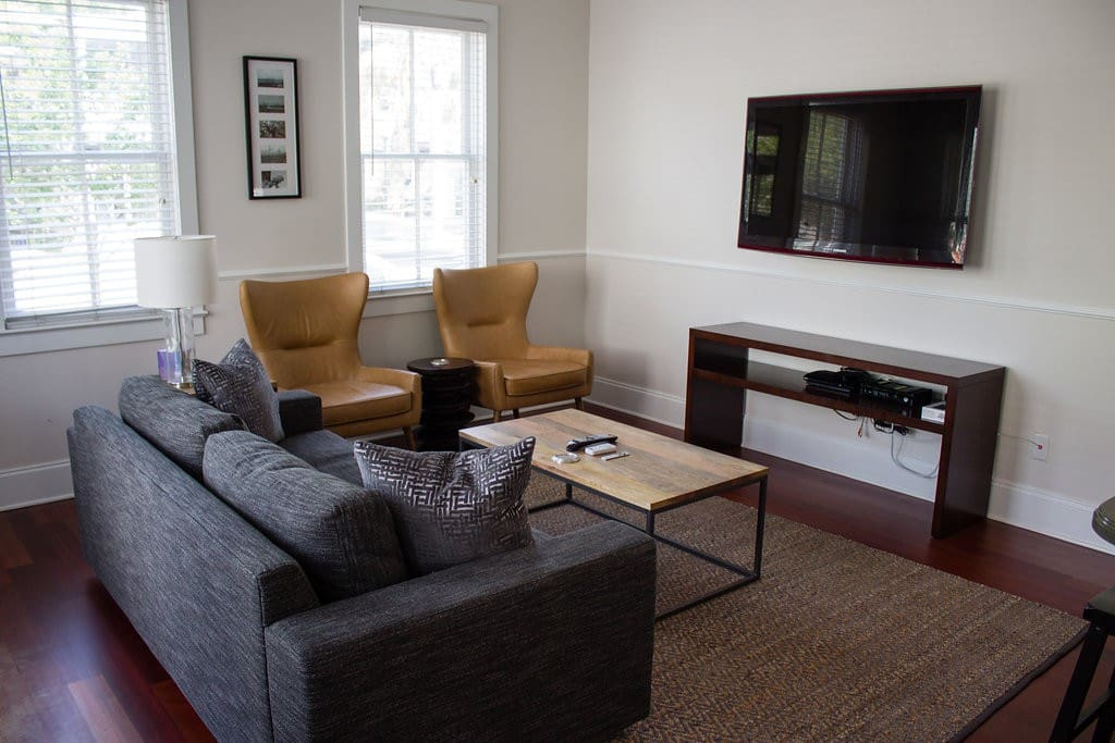Living room beautifully designed by West Elm on King Street includes Apple TV