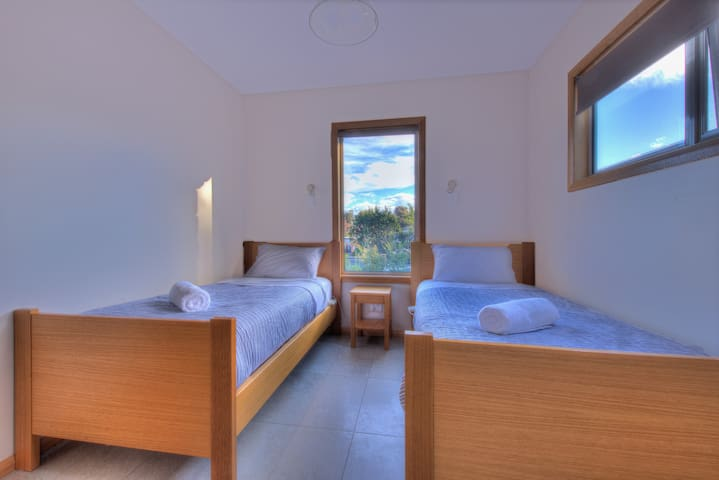 The twin beds are very comfortable, with a garden outlook.