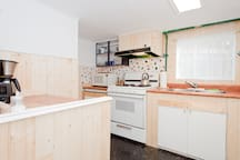 Full kitchen with gas stove.