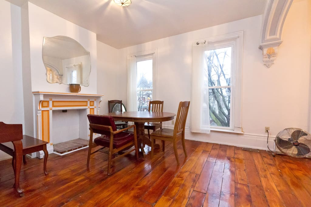 Living/Dining Room with hardwood floors...and a piano