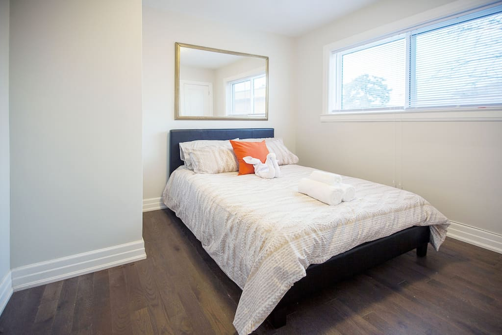 Comfortable bed with Clean Bedsheets and Comforters