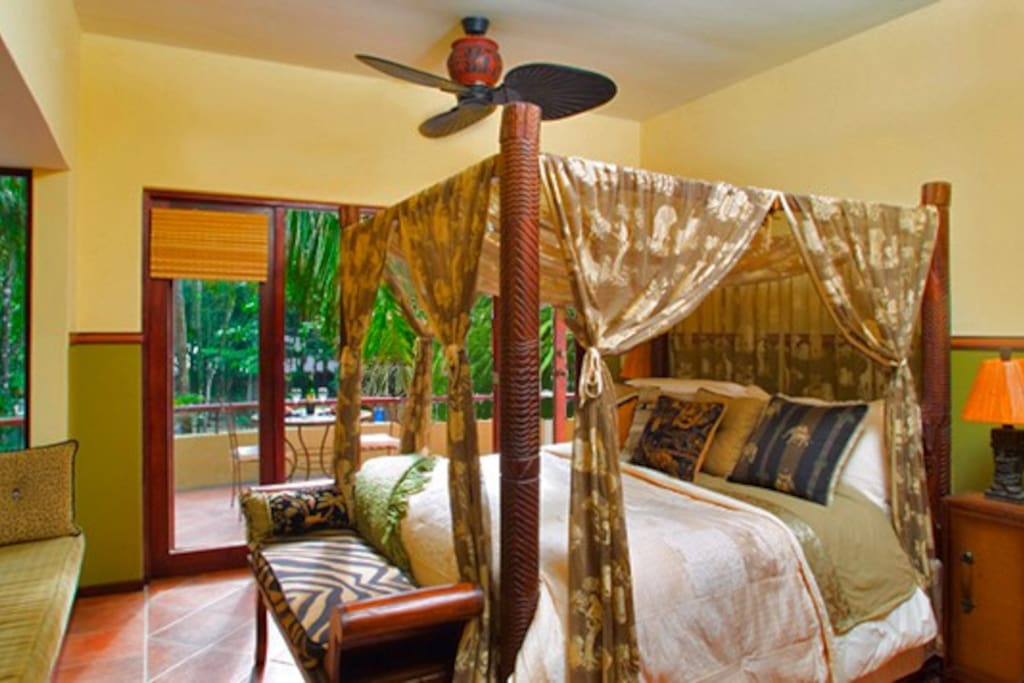 The Master Bedroom has a romantic canopy bed, a private balcony and an ocean view.