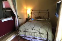 Queen bedroom off front room