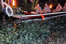 Mitai Maori Village experience with warriors paddling the waka up the sacred spring
