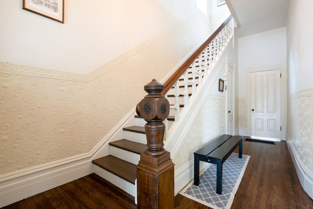 Victorian details like grand wooden staircase, printed tin/plaster on walls, and recently refinished original wood floors.