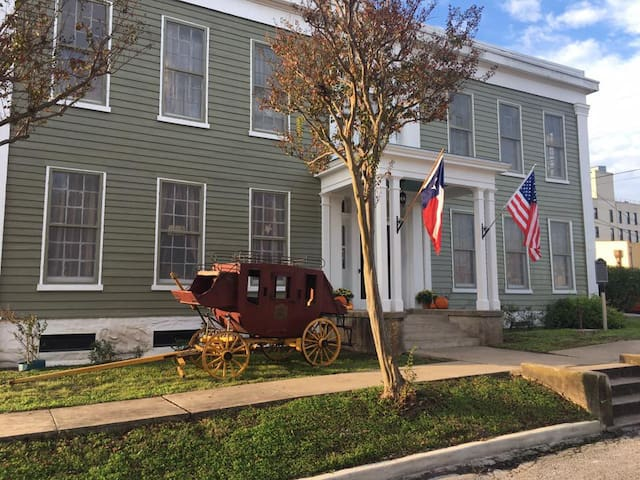 This is the front view of the 1840 Historic Magnolia Hotel that leads into the museum area. The bottom floor was once a log cabin, then stagecoach stop. The second floor was added in 1850 which became the elegant frontier Magnolia Hotel.
