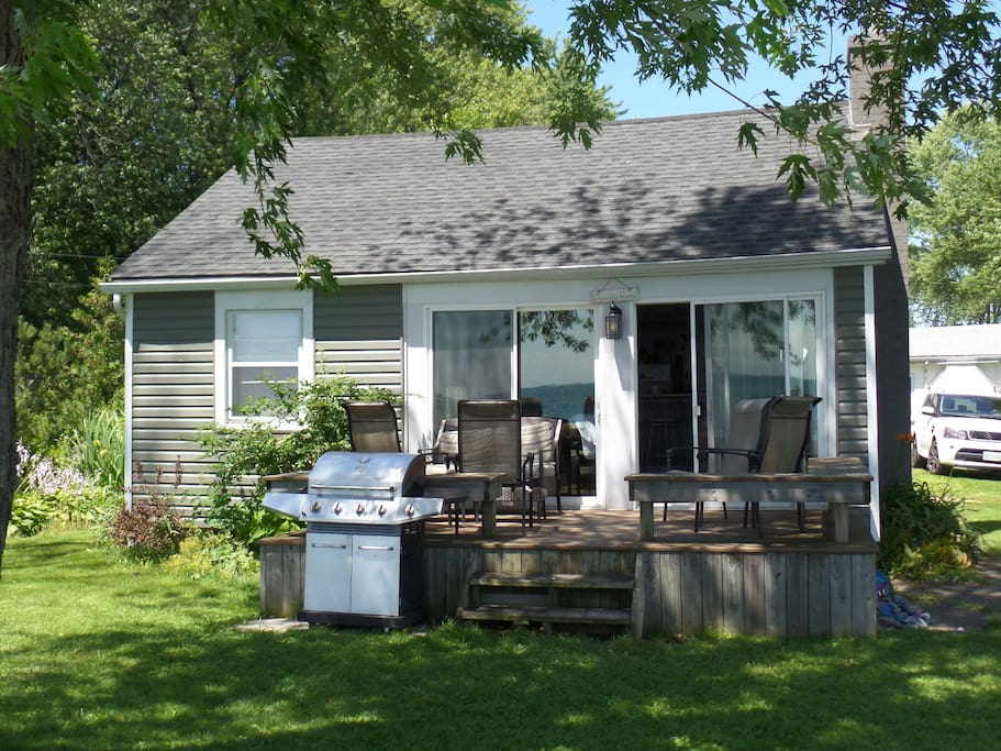 Adorable exterior with front deck and BBQ