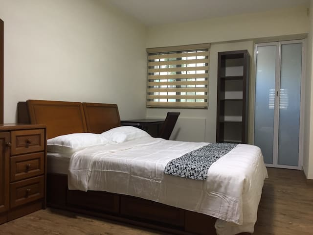Master Bedroom has a queen bed, a built in wardrobe, dressing table, study table and attached bathroom.