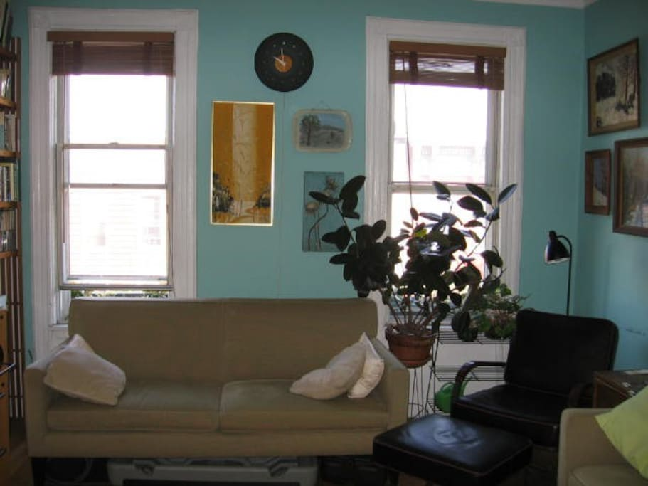 Another living room shot. The windows look out onto the street. The big TV is on the left, out of view.