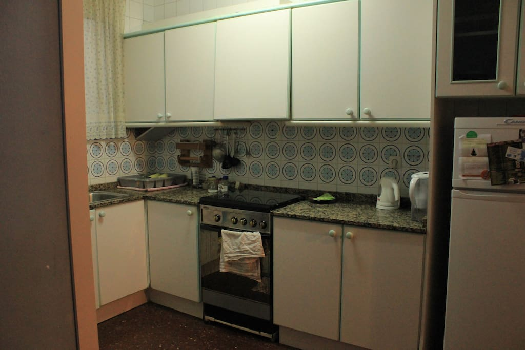Kitchen: sink, stove and refrigerator.