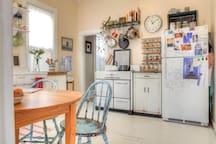 Bright, cheerful eat in kitchen with tons of morning sunlight.