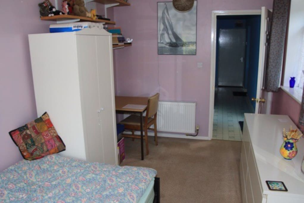 The room also has a small desk and chair. There is also an adjoining WC.