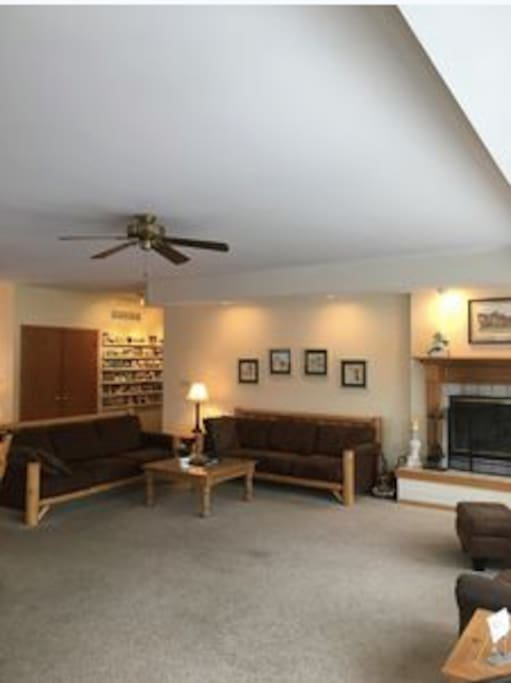 Great room with wood burning fireplace.