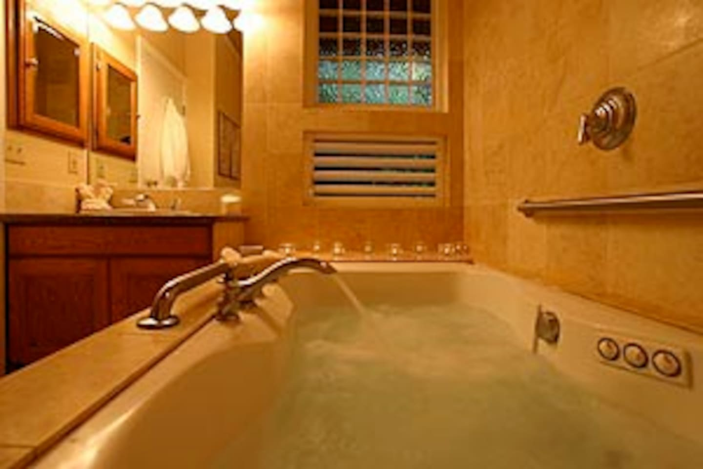 Large Jacuzzi tub with rainfall shower.  Room for two.