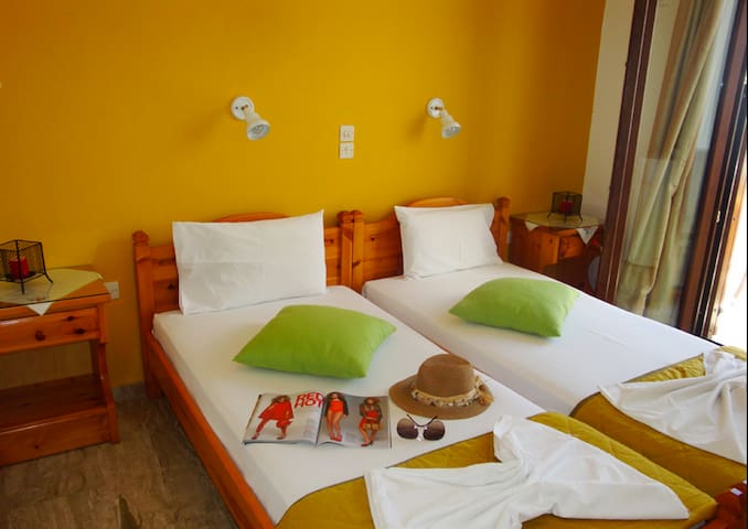 Vassiliki Rooms,50 metres from the beach.!