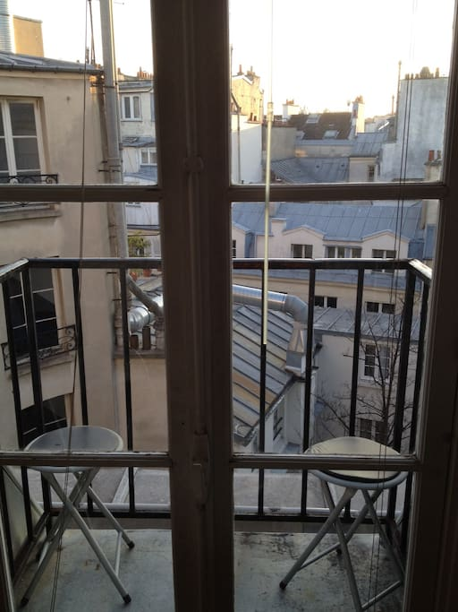 One of the two sunny balconies overlooking the roofs of Paris