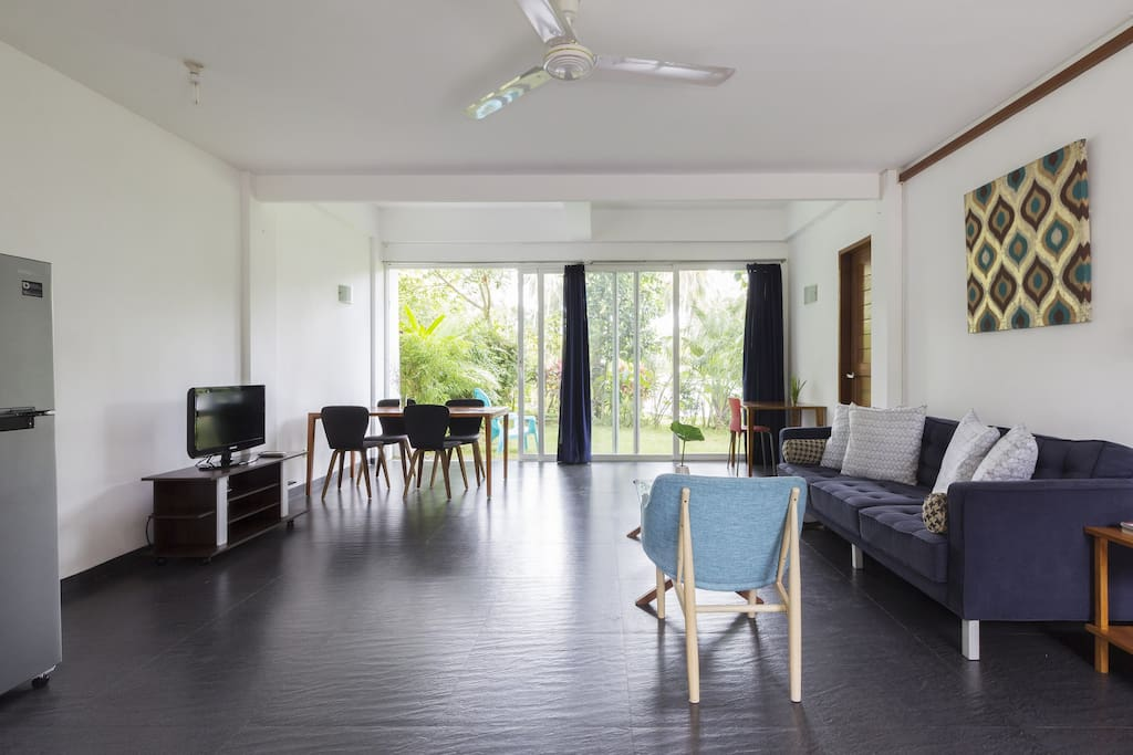 Spacious living area with an open space to view the garden and swimming pool