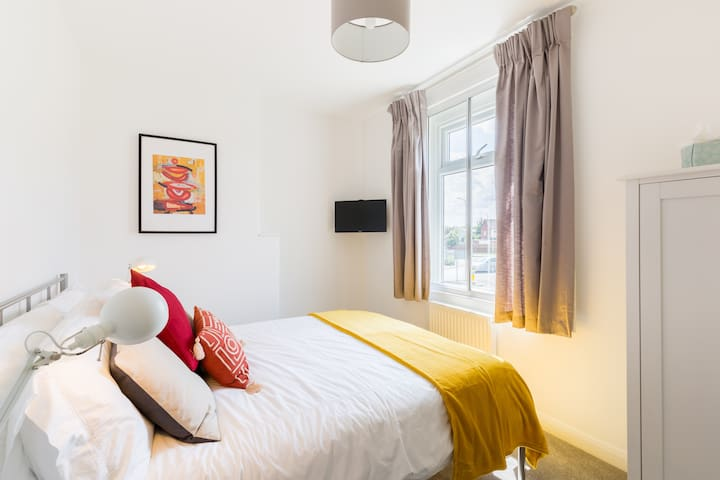 Smaller double bedroom with triple glazing for a quiet night, smart TV, White Co Egyptian cotton bedding, hairdryer and full length mirror.