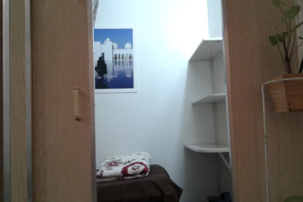 Solo room with comfortable bed spacious storage