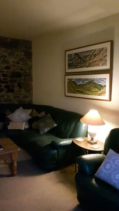 Original stone wall in lounge.