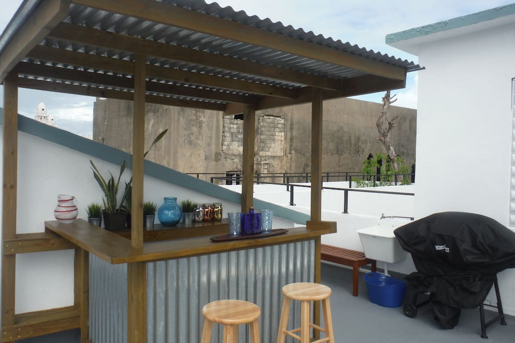 Our 'Hurricane Bar'  is a great place to hang out and chill after a day of exploring San Juan!The bar also doubles as an outdoor kitchen with gas BBQ grill, utility sink and lots of prep area.