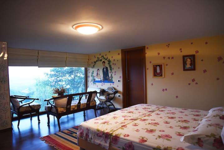 Bedroom with stunning view and en-suite bathroom