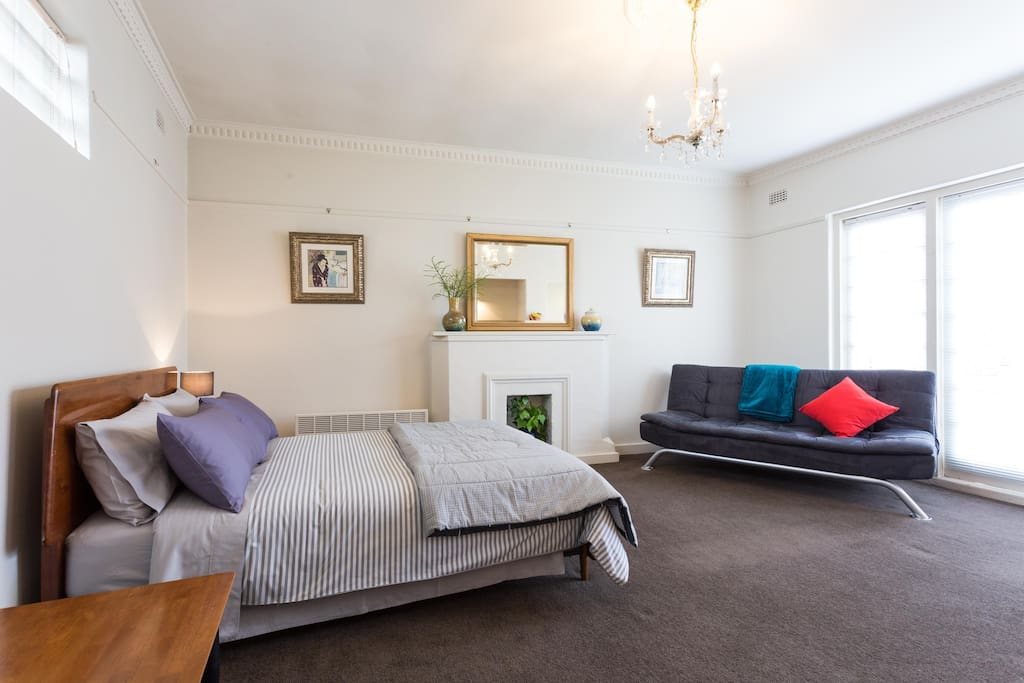 Large, bed/living area, couch
