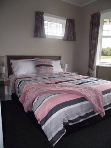 Second room Queen bed.