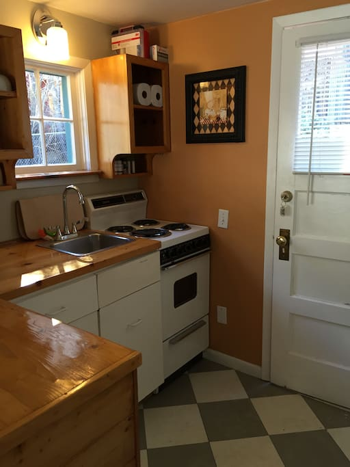 Kitchen with stove, fridge and microwave (all proportional to size!)