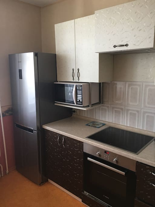 Kitchen with microwave, fridge, oven