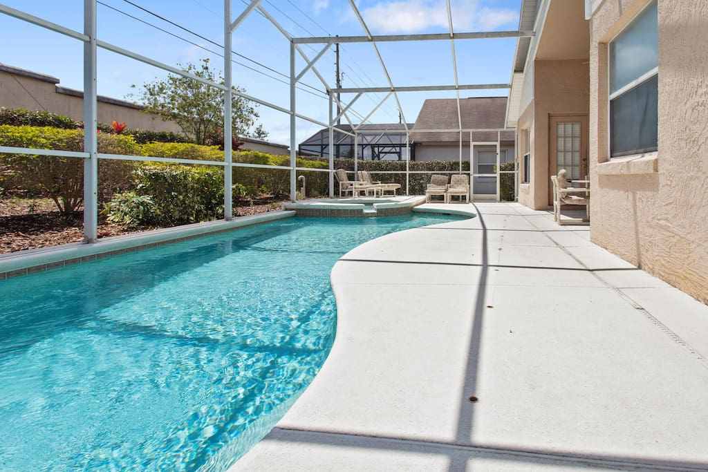 The pool and deck area at this spacious vacation home is a great area to relax and take a dip after a long day at the area theme parks.