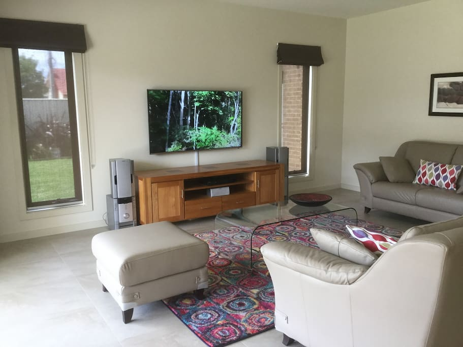 Spacious living area looking out to lawn & alfresco area.