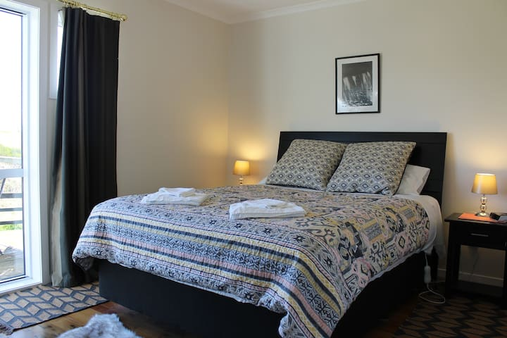 Comfortable queen bed with extra bedding.