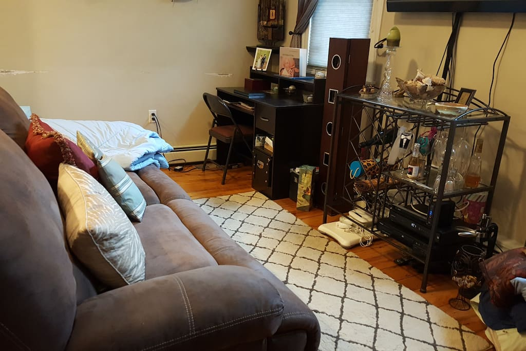 Living room with power reclining sofa that can lay almost flat and a desk area
