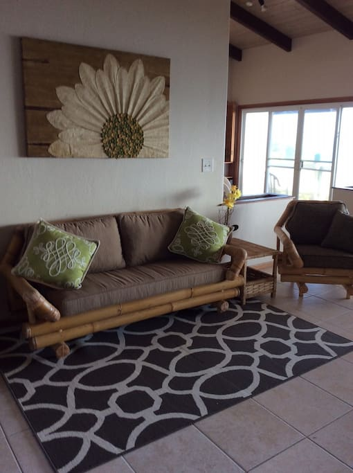 Comfortably furnished, with new upholstered cushions, tile flooring, vaulted wood ceilings, fans and AMAZING views!