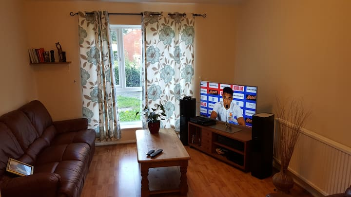 A large room in a clean town centre house/parking