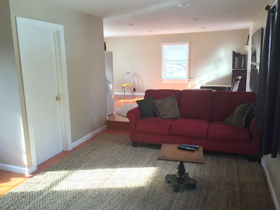 Open concept living room and dining room. Couch converts to a queen bed.