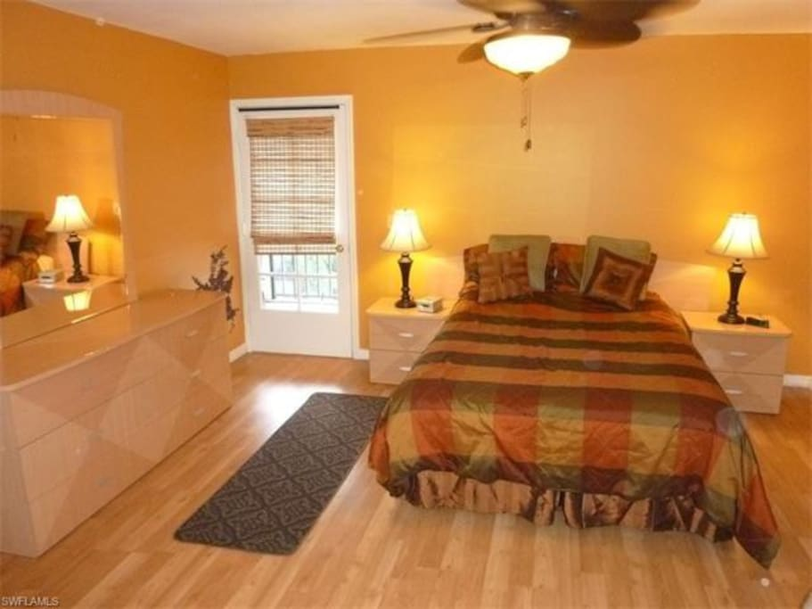 Master bedroom has direct access to the balcony.